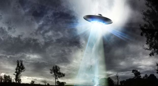 ufo-beaming-up-a-man-101297756-591793353df78c7a8ca44722